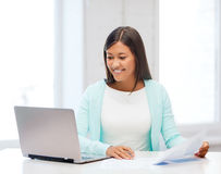 Asian businesswoman with laptop and documents Royalty Free Stock Photo