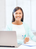 Asian businesswoman with laptop and documents Stock Photos