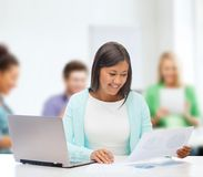 Asian businesswoman with laptop and documents Royalty Free Stock Photos