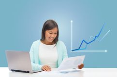 Asian businesswoman with laptop and documents Stock Images