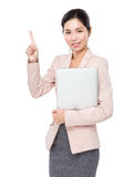 Asian businesswoman with laptop and finger point up Stock Images