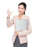 Asian businesswoman with laptop and ok sign Royalty Free Stock Images