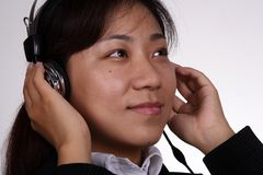 Asian businesswoman listening Royalty Free Stock Photography