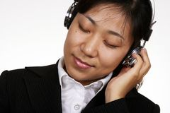 Asian businesswoman listening Royalty Free Stock Image