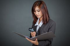 Asian businesswoman look at data in folder Royalty Free Stock Photo