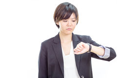 Asian businesswoman looking at watch Royalty Free Stock Photography