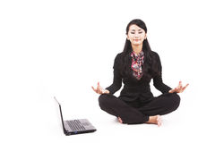 Asian businesswoman meditating Royalty Free Stock Image