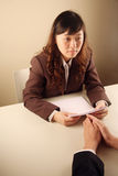 Asian businesswoman in a meeting. With a client royalty free stock photo