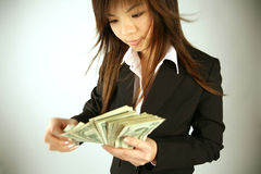 Asian businesswoman with money Royalty Free Stock Photography