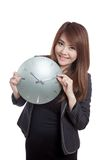 Asian Businesswoman move a clock hand and smile Royalty Free Stock Images