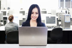 Asian businesswoman in office work place Royalty Free Stock Photo