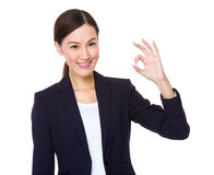 Asian businesswoman with ok sign gesture Royalty Free Stock Photo