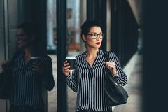 Businesswoman outside office building with a coffee Royalty Free Stock Image