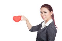 Asian businesswoman pick a red heart in the air Royalty Free Stock Photography
