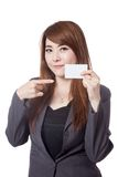 Asian Businesswoman point at a blank card Royalty Free Stock Images