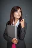 Asian businesswoman point with a pen look at her left Stock Photography