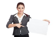 Asian businesswoman point to a blank sign on her h Royalty Free Stock Image