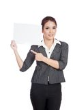 Asian businesswoman point to a blank sign on her s Stock Images