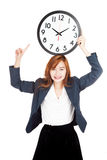 Asian businesswoman point to clock over head Royalty Free Stock Photography