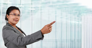Asian businesswoman pointing away Stock Images