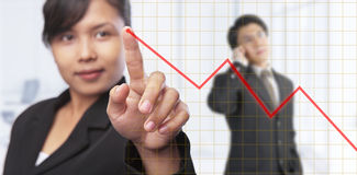 Asian businesswoman pointing graph Stock Images