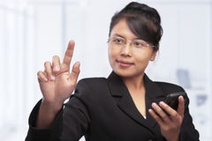 Asian businesswoman pointing her finger tip Stock Photo