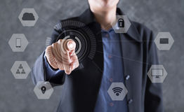 Asian businesswoman pointing, pressing or touching button on vir Stock Image