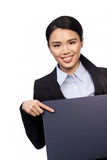 Asian businesswoman pointing to a board Royalty Free Stock Photography