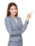 Asian businesswoman pointing to empty space. Isolated on white background stock photo