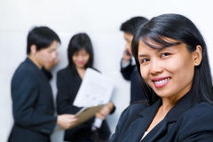 Asian businesswoman posing in front of the other