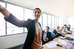 Asian businesswoman presenting her ideas to colleagues Stock Photo