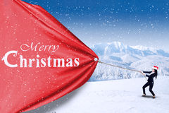 Asian businesswoman pull christmas banner Royalty Free Stock Image