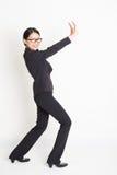 Asian businesswoman pushing something Stock Images