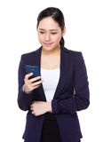 Asian businesswoman read on cellphone Stock Image