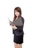 Asian businesswoman read data from folder Stock Photos