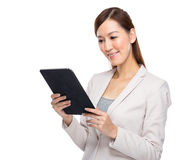 Asian businesswoman read on digital tablet Stock Photos