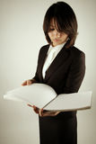 Asian businesswoman reading Royalty Free Stock Photography