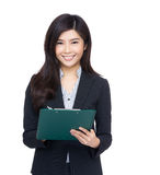 Asian businesswoman record with clipboard Stock Images