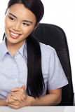 Asian businesswoman seated at her desk Royalty Free Stock Photography