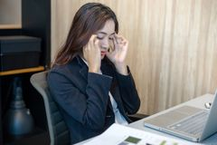 Asian businesswoman serious about the work hard done until the stock photo