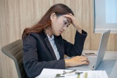 Asian businesswoman serious about the work hard done until the stock photos