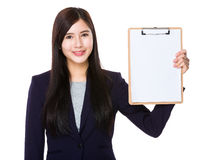 Asian businesswoman show with the blank page of clipboard. Isolated on white background Royalty Free Stock Images
