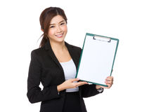 Asian businesswoman show with the blank page of clipboard. Isolated on white background Stock Photography