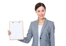 Asian businesswoman show with blank page of clipboard Royalty Free Stock Images