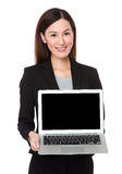 Asian businesswoman show with the blank screen of laptop compute Royalty Free Stock Photography