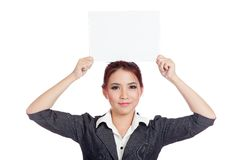 Asian businesswoman show a blank sign over her hea Stock Photo