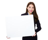 Asian Businesswoman show with blank white banner royalty free stock image