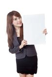 Asian businesswoman  show a vertical  blank sign on her left Stock Images