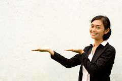 Asian businesswoman showing blank space stock images