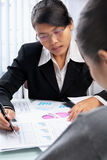 Asian businesswoman showing data Stock Images